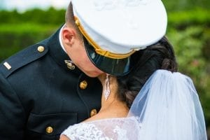 Military wedding, bride and groom embrace.
